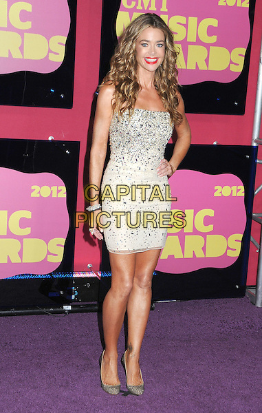 Denise Richards.2012 CMT Music Awards held at Bridgestone Arena, Nashville, Tennessee, USA..June 6th, 2012.full length white dress silver embellished jewel encrusted hand on hip.CAP/ADM/LF.©Laura Farr/AdMedia/Capital Pictures.