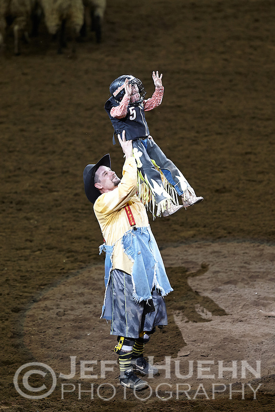 SAN ANTONIO, TX - FEBRUARY 23, 2013: Bull fighter Travis Adams congratulates a contestant during the Mutton Bustin' portion of the PRCA Xtreme Bulls competition during the 2013 San Antonio Stock Show & Rodeo at the AT&T Center. (Photo by Jeff Huehn)