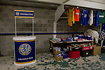 Macclesfield Town 0 Gateshead 4, 22/02/2013. Moss Rose, Football Conference. The fans information point and souvenir kiosk under the stand before Macclesfield Town host Gateshead at Moss Rose in a Conference National fixture. The visitors from the North East who were in the relegation zone, shocked Macclesfield with four first half goals and won 4-0 in front of 1467 fans. Both teams were former members of the Football league, with Macclesfield dropping out in 2012. Photo by Colin McPherson.