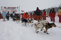 Travis Beals of Seward leaves the start line of the 2009 Junior Iditarod on Knik Lake on Saturday Februrary 28, 2009.