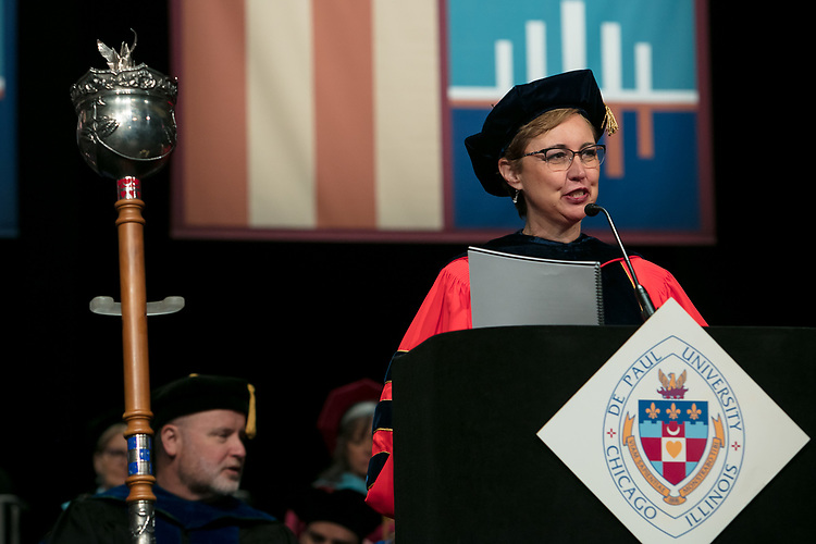 Roxanne Owens, department chair and associate professor, serves as the university marshal Saturday, June 10, 2017, during the DePaul University College of Education commencement ceremony at the Rosemont Theatre in Rosemont, IL. (DePaul University/Jeff Carrion)