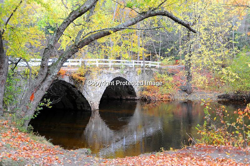 Stone Arch Bridge with Fall Foliage in Keene, New Hampshire USA