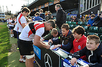 Francois Louw of Bath Rugby signs autographs for supporters after the session. Bath Rugby Captain's Run on February 19, 2016 at the Recreation Ground in Bath, England. Photo by: Patrick Khachfe / Onside Images