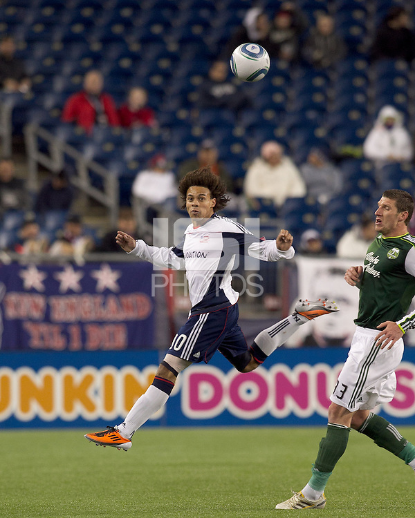 New England Revolution defender Kevin Alston (30) heads the ball. In a Major League Soccer (MLS) match, the New England Revolution tied the Portland Timbers, 1-1, at Gillette Stadium on April 2, 2011.