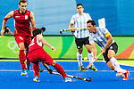 Captain Pedro Ibarra #5 of Argentina controls the ball during Argentina vs Belgium  in the men's gold medal game at the Rio 2016 Olympics at the Olympic Hockey Centre in Rio de Janeiro, Brazil.