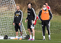 Pictured: Michu (C) with Ashley Jazz Richards (L) and Chico Flores (R). Saturday 08 March 2014<br />