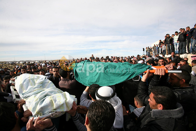 Palestinian mourners carry the bodies of two boys who were killed the previous day when unexploded military ordinance detonated outside Hebron, during their funeral in Wadi al-Rim, West Bank, 07 March 2012. Palestinian police announced on 06 March that two 12-year-old Palestinian boys, Hamza Jaradat and Zayed Jaradat, were killed, and three others injured, when unexploded ordinance exploded.  Photo by Ismail Youssef