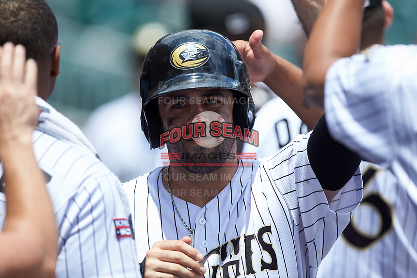 Ryan LaMarre (28) of the Charlotte Knights is congratulated by his teammates after scoring a run against the Indianapolis Indians at BB&T BallPark on August 22, 2018 in Charlotte, North Carolina.  The Indians defeated the Knights 6-4 in 11 innings.  (Brian Westerholt/Four Seam Images)