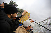 Pictured: Migrants protesting Monday 29 February 2016<br /> Re: A crowd of migrants has burst through a barbed-wire fence on the FYRO Macedonia-Greece border using a steel pole as a battering ram.<br /> TV footage showed migrants pushing against the fence at Idomeni, ripping away barbed wire, as FYRO Macedonian police let off tear gas to force them away.<br /> A section of fence was smashed open with the battering ram. It is not clear how many migrants got through.<br /> Many of those trying to reach northern Europe are Syrian and Iraqi refugees.<br /> About 6,500 people are stuck on the Greek side of the border, as FYRO Macedonia is letting very few in. Many have been camping in squalid conditions for a week or more, with little food or medical help.
