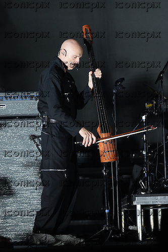 PETER GABRIEL - bassist Tony Levin - performing live on the So - Back to Front Tour at the O2 Arena in London UK - 21 Oct 2013.  Photo credit: George Chin/IconicPix