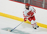 MADISON, WI - SEPTEMBER 29: Emily Morris #6 of the Wisconsin Badgers women's hockey handles the puck against the Quinnipiac Bobcats at the Kohl Center on September 29, 2006 in Madison, Wisconsin. The Badgers beat the Bobcats 3-0. (Photo by David Stluka)