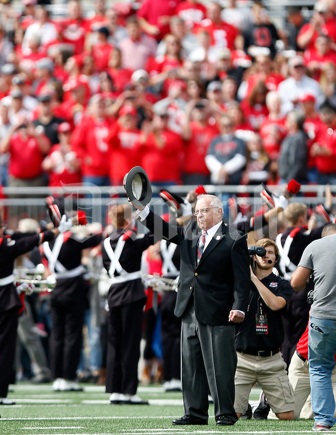 "Former head football coach Earle Bruce dots the ""i"" in Script Ohio before the NCAA football game between the Ohio State Buckeyes and the Rutgers Scarlet Knights at Ohio Stadium on Saturday, October 1, 2016. (Columbus Dispatch photo by Jonathan Quilter)"