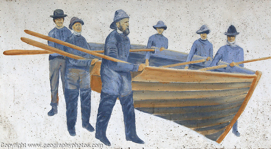 Picture of lifeboat crew on sea wall, Sheringham, Norfolk, England, UK