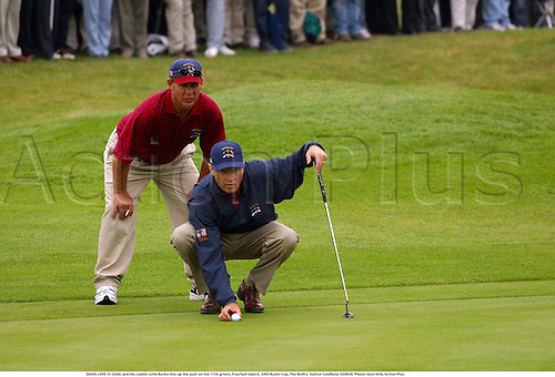 DAVIS LOVE III (USA) and his caddie John Burke line up the putt on the 11th green, Fourball Match, 34th Ryder Cup, The Belfry, Sutton Coldfield, 020928. Photo: Glyn Kirk/Action Plus....2002.golf golfer playing.putts putting