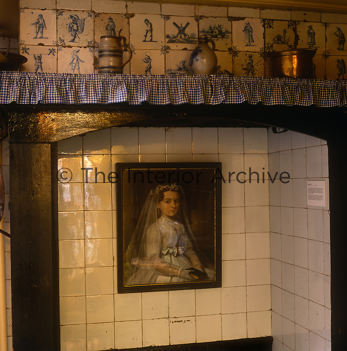 The interior of the OLITA (Our Lord In The Attic) museum. The attic of this bourgeois house conceals a secret Catholic church, known as Ons' Lieve Heer op Solder (Our Dear Lord in the Attic), originally built in 1663, when Catholics lost their right to workship in their own way. The lower floors of the building became a museum in 1888 and today contain refurbished rooms such as a kitchen with Delft tiles.