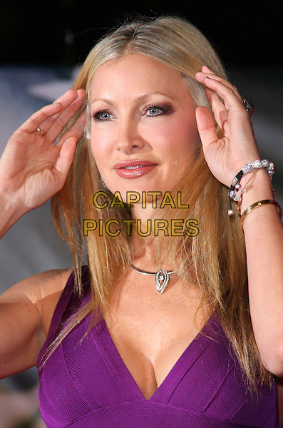 "Caprice Bourret.The ""Michael Jackson : The Life Of An Icon"" UK premiere, Empire cinema, Leicester Square, London, England..2nd November 2011.headshot portrait purple hands arms bracelets necklace .CAP/ROS.©Steve Ross/Capital Pictures."