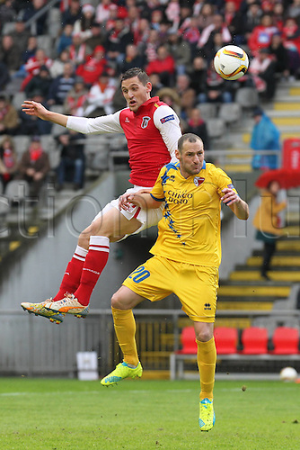 24.02.2016. Braga, Portugal. Stojiljkovic of SC Braga challenges Vanczak of FC Sion during the UEFA Europa League match, Round of 32 - 2nd Leg, at Estadio Municipal de Braga, in Braga. Braga versus FC Sion
