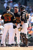 September 2 2008:  Pitching Coach Stu Cliburn, Catcher Ryan Jorgenson, and pitcher Brian Duensing of the Rochester Red Wings, Class-AAA affiliate of the Minnesota Twins, during a game at Frontier Field in Rochester, NY.  Photo by:  Mike Janes/Four Seam Images