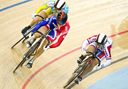 19 FEB 2012 - LONDON, GBR - Great Britain's Victoria Pendleton (GBR) (second from left in red and blue) attempts to pass Russia's Viktoria Baranova (RUS) during a round of the Women's Keirin at the UCI Track Cycling World Cup, and London Prepares test event for the 2012 Olympic Games, in the Olympic Park Velodrome in Stratford, London, Great Britain (PHOTO (C) 2012 NIGEL FARROW)