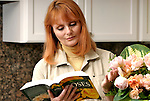 Mature woman consulting book on roses