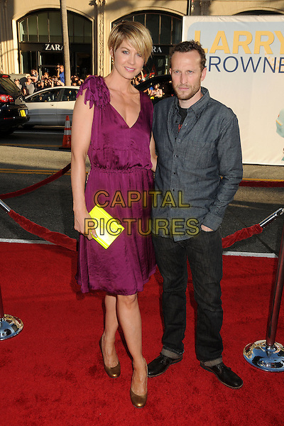 """Jenna Elfman & Bodhi Elfman.""""Larry Crowne"""" Los Angeles Premiere held at Grauman's Chinese Theatre.  Hollywood, California, USA..27th June 2011.full length purple dress sleeveless gold bronze shoes clutch jimmy choo neon fluorescent yellow jeans denim grey gray shirt married husband wife tall short.CAP/ADM/BP.©Byron Purvis/AdMedia/Capital Pictures."""