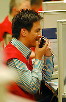 Staff working in Hong Kong Exchange in Hong Kong, China. Falling metals and oil prices coupled with concerns over the US economy kept regional benchmarks in negative territory Monday. Asian benchmarks have been tumbled during the past weeks and lift Hang Seng Index in rollar-coaster trade..23 May 2006
