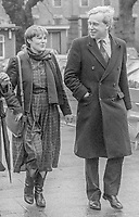 Mary Flaherty, TD, Fine Gael, politician, Rep of Ireland, arriving Leinster House for the opening of the recently-elected Dail Eireann, Irish Parliament, 14th December 1982. She is accompanied by her husband, Alexis Fitzgerald, who failed to win a seat. He was subsequently elected to the Senate. 198212140320MOF+AF. <br /> <br /> Copyright Image from Victor Patterson, 54 Dorchester Park, <br /> Belfast, UK, BT9 6RJ<br /> <br /> t1: +44 28 9066 1296 (from Rep of Ireland 048 9066 1296)<br /> t2: +44 28 9002 2446 (from Rep of Ireland 048 9002 2446)<br /> m: +44 7802 353836<br /> <br /> victorpatterson@me.com<br /> www.victorpatterson.com<br /> <br /> Please see my Terms and Conditions of Use at VICTORPATTERSON.COM. It is IMPORTANT that you familiarise yourself with them.<br /> <br /> Images used on the Internet must be visibly watermarked i.e. &copy;VICTORPATTERSON.COM within the body of the image and copyright metadata must not be deleted. Images used on the Internet have a size restriction of 4kbs and are chargeable at the then current NUJ rates.<br /> <br /> This image is only available for the use of the download recipient i.e. television station, newspaper, magazine, book publisher, etc, and must not be passed on to any third party. It is also downloaded on condition that each and every usage is notified within 7 days to victorpatterson@me.com<br /> <br /> The right of Victor Patterson to be identified as the author is asserted in accordance with The Copyright Designs And Patents Act (1988).