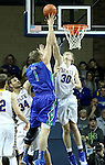 SIOUX FALLS, SD - NOVEMBER 30:  Connor Devine #30 from South Dakota State University blocks the shot of Nate Hicks #1 from Florida Gulf Coast in the second half of their game Sunday afternoon at the Sanford Pentagon in Sioux Falls. (Photo by Dave Eggen/inertia)