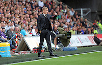 Pictured: Swansea manager Garry Monk gives the thumbs up after his team went 2-1 up Sunday 30 August 2015<br />