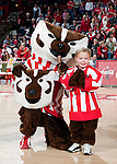 Wisconsin Badgers mascot Bucky Badger poses with the winner of the Halloween costume contest during an NCAA volleyball match against the Michigan Wolverines at the Field House on October 30, 2010 in Madison, Wisconsin. Michigan won the match 3-1. (Photo by David Stluka)