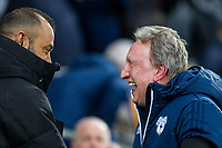 Wolverhampton Wanderers manager Nuno Espirito Santo greets Cardiff City manager Neil Warnock ahead of the Sky Bet Championship match between Cardiff City and Wolverhampton Wanderers at the Cardiff City Stadium, Cardiff, Wales on 6 April 2018. Photo by Mark  Hawkins / PRiME Media Images.