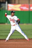 Peoria Chiefs shortstop Juan Herrera (12) throws to first during a game against the Kane County Cougars on June 2, 2014 at Dozer Park in Peoria, Illinois.  Peoria defeated Kane County 5-3.  (Mike Janes/Four Seam Images)