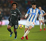 Christopher Schindler of Huddersfield Town  clears under pressure from Willian of Chelsea during the premier league match at the John Smith's Stadium, Huddersfield. Picture date 12th December 2017. Picture credit should read: Simon Bellis/Sportimage