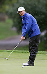 SIOUX FALLS, SD - SEPTEMBER 23: Dylan Baker from South Dakota State University rolls a putt through the rain on the 2nd hole of the final round at the 2014 Jackrabbit Invitational Tuesday morning at Minnehaha Country Club.(Photo by Dave Eggen/Inertia)