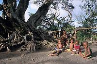 Six melanesian children playing together near a banyan tree, Sulphur Bay, Tanna Island, Vanuatu