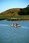 California:  Kayakers near Monterey at Elkhorn Slough.  Model released..Photo copyright Lee Foster, 510-549-2202, lee@fostertravel.com, www.fostertravel.com..Photo #: caelkh103