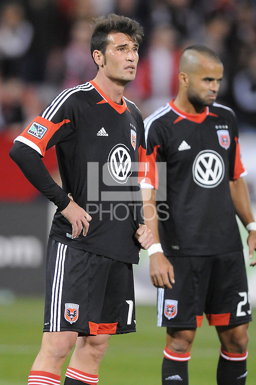 D.C. United defender Emiliano Dudar (19) left with forward Maicon Santos (29) right. D.C. United tied the Seattle Sounders, 0-0 at RFK Stadium, Saturday April 7, 2012.