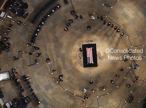 The late U.S. Sen. John McCain, R-Ariz., lies in state in the U.S. Capitol Rotunda Friday, Aug. 31, 2018, in Washington. (Pool photo by Morry Gash via AP)