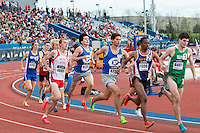 York High School's Matt Plowman tries to get out to lane 2 while Blue Springs Stephen Mugeche tries to prevent a fall in the 1600 at the 2015 Kansas Relays.