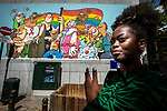 Brussels - Belgium - 29 June 2020 -- Rachael Moore, the Coordinator of the Brussels RainbowHouse, which shelters various French- and Dutch-speaking LGBTQI (lesbians, gays, bisexuals, transgenders, queers, intersexuals) organizations of the Brussels region. LGBTQI fresco by Ralf König. — PHOTO: Juha ROININEN / EUP-IMAGES