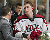Brendan Flemming (Harvard - Dir-HockeyOps), Danny Fick (Harvard - 7) - The Harvard University Crimson honored their seniors following their final home game of the regular season on Saturday, February 22, 2014 at the Bright-Landry Hockey Center in Cambridge, Massachusetts.