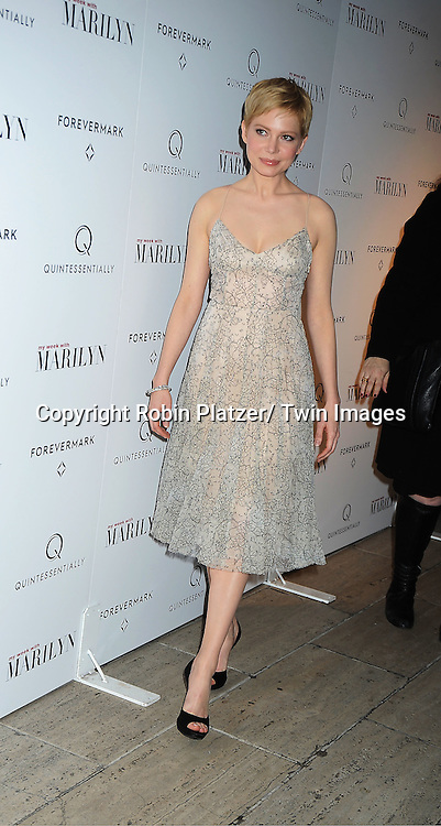 """actress Michelle Williams in Erdem dress attends The New York Premiere of """"My Week With Marilyn"""" on November 13, 2011 at the Paris Theatre in New York City. The movie stars Michelle Williams, Kenneth Branagh, Dominic Cooper and Zoe Wanamaker."""