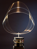 STANDING WAVE ON CIRCULAR HOOP<br /> (Variations Available)<br /> Analog - de Broglie Wavelengths &amp; Bohr Orbits<br /> A circular hoop of wire is vibrated at a variable frequency. At a frequency of 19 Hz the standing wave is visible on the wire- analagous  to the de Broglie formula for the electron orbital and showing the wave-particle duality of matter.