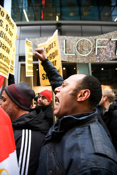 """Egyptians, Egyptian-Americans, and other supporters rally in Times Square for """"Day of Departure: New York Rallies for Egypt"""" before marching to the Egyptian Mission to the United Nations on 04 February 2011 in New York City, New York. The event was planned to coincide with a huge demonstration in Cairo, Egypt, where President Hosni Mubarak continues to refuse to resign amid massive protests."""