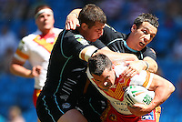 PICTURE BY VAUGHN RIDLEY/SWPIX.COM - Rugby League - Super League Magic Weekend - Catalans Dragons v London Broncos - Eithad Stadium, Manchester, England - 27/05/12 - Catalans Clint Greenshields is tackled by Londons Tony Clubb and Michael Witt.