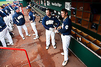 Cam Schiller (9) of the Oral Roberts Golden Eagles talks with a teammate in the dugout during a game against the Missouri State Bears on March 27, 2011 at Hammons Field in Springfield, Missouri.  Photo By David Welker/Four Seam Images