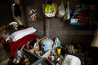 Abu Bashir's Home. <br /> <br /> Calais Jungle Camp.<br /> <br /> Under the Sky of Calais &amp; Dunkirk. Two Camps, Two Sides of the Same Coin: Not 'migrants', Not 'refugees', just Humans.<br /> <br /> France, 24-30/03/2016. Documenting (and following) Zekra and her experience in the two French camps at the gate of the United Kingdom: Calais' &quot;Jungle&quot; and Dunkirk's &quot;Grande-Synthe&quot;. Zekra lives in London but she is originally from Basra in Iraq. Zekra and her family had to flee Kuwait - where they moved for working reason - due to the &quot;Gulf War&quot;, and to the Western Countries' will to &quot;export Democracy in Iraq&quot;. Zekra is a self-motivated volunteer and founder of &quot;Happy Ravers&quot;, a group of people (not a NGO or a charity) linked to each other because of their love for rave parties but also men and women who meet up every week to help homeless people and other people in need in Central London. (Here there are some of the stories I covered about Zekra and &quot;Happy Ravers&quot;: http://bit.ly/1XVj1Cg &amp; http://bit.ly/24kcGQz &amp; http://bit.ly/1TY0dPO). Zekra worked as an English teacher in the adult school at Dunkirk's &quot;Grande-Synthe&quot; camp and as a cultural mediator and Arabic translator for two medic teams in Calais' &quot;Jungle&quot;. Please read her story at the beginning of this reportage.