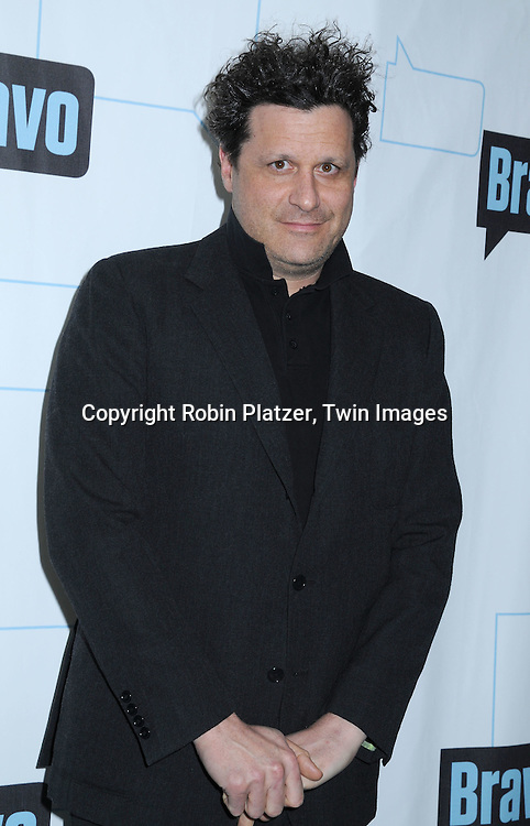 Isaac Mizrahi posing for photographers at The Bravo Upfront Party on March 10, 2010 at Skylight Studios in New York City.