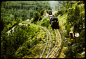 D&amp;RGW #480 K-36 hauling pipe? Or lumber? - caboose - Garfield switchback.<br /> D&amp;RGW  Garfield Switchback, CO