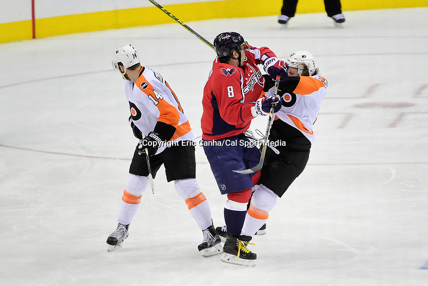 Thursday, April 14, 2016: Philadelphia Flyers center Ryan White (25) is checked by Washington Capitals left wing Alex Ovechkin (8) during game 1 of the first round of the National Hockey League Eastern Conference playoffs  between the Philadelphia Flyers and the Washington Capitals held at the Verizon Center in Washington, DC. Washington defeats Philadelphia 2-0. Eric Canha/CSM